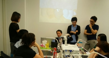 Dr Chong Isaac giving a presentation and hands-on workshop on Tooth Coloured Bonding and Fillings to dentists